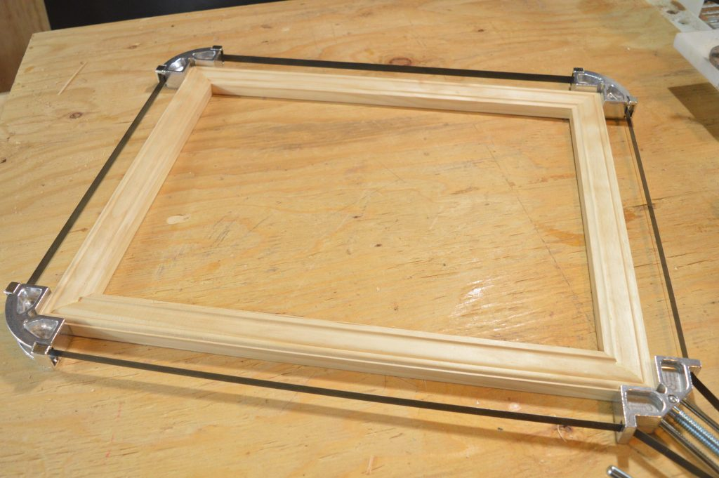 DIY picture frame clamping with the Merle Band Clamp.