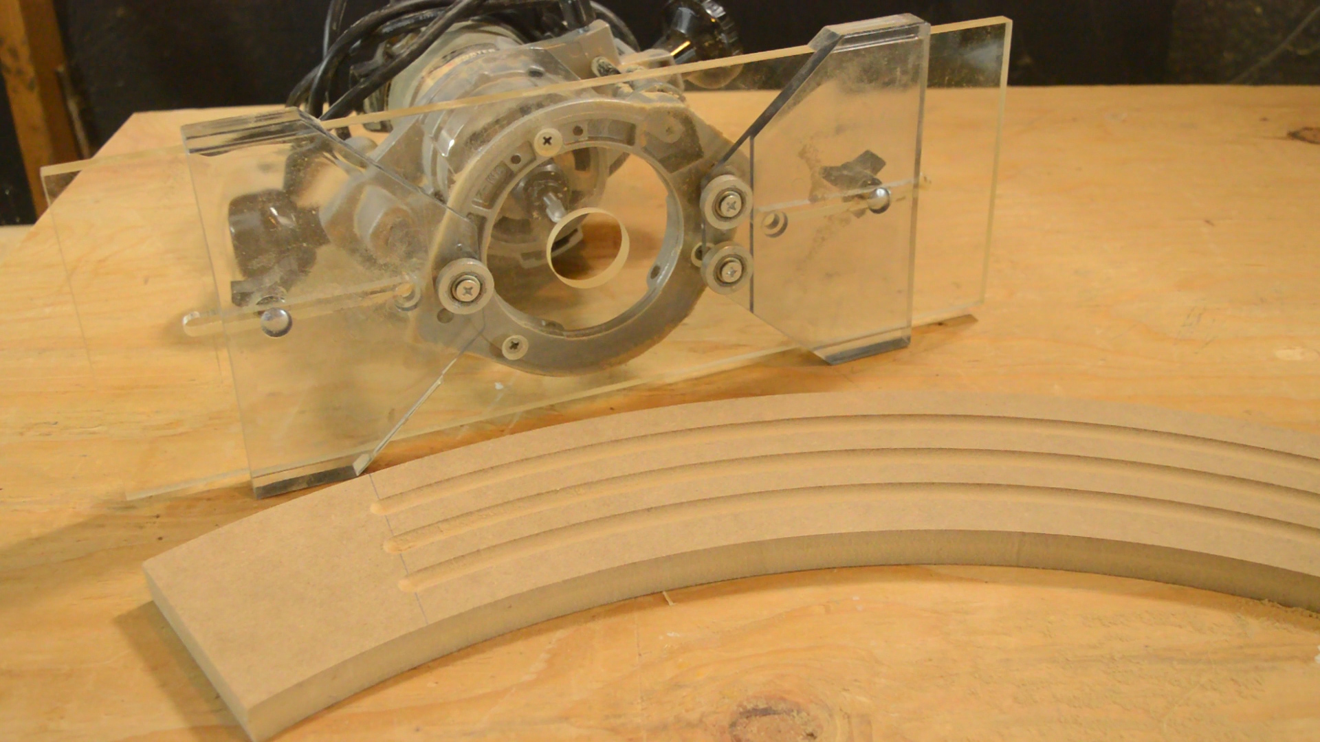 The Eagle America Arched Fluting Jig and a completed curved molding.