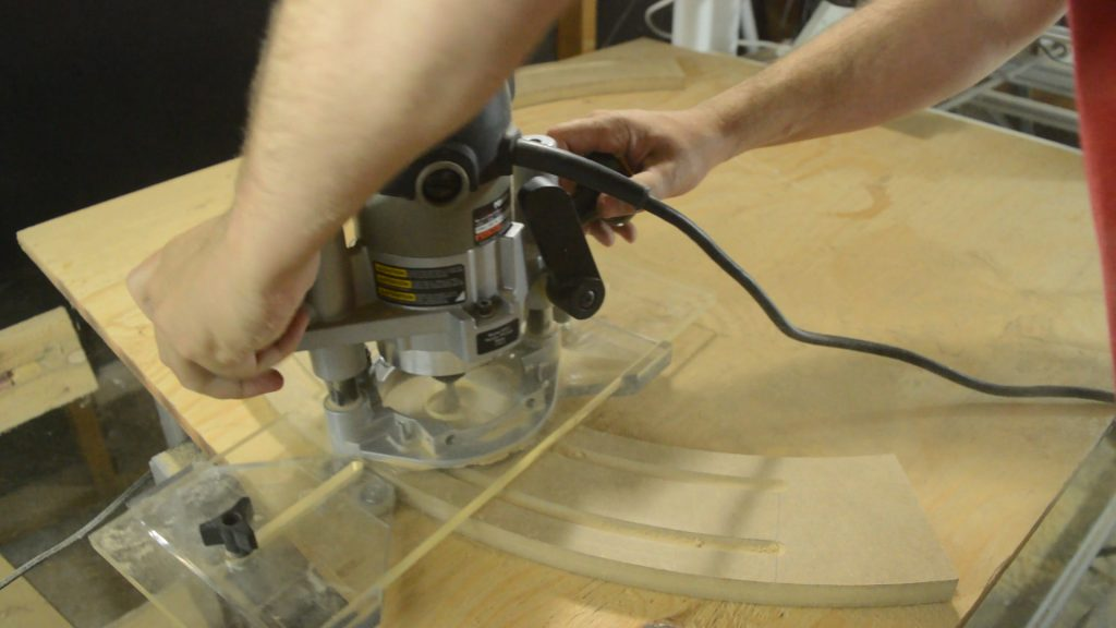 Routing the curved molding flute with the Eagle America Arched Fluting Jig.