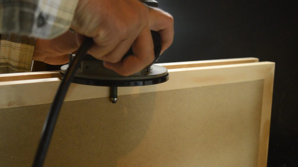 Flush trim the edge banding if it's thicker than your panel stock.