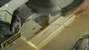 Routing the ends of the mitered door frame stock pieces.